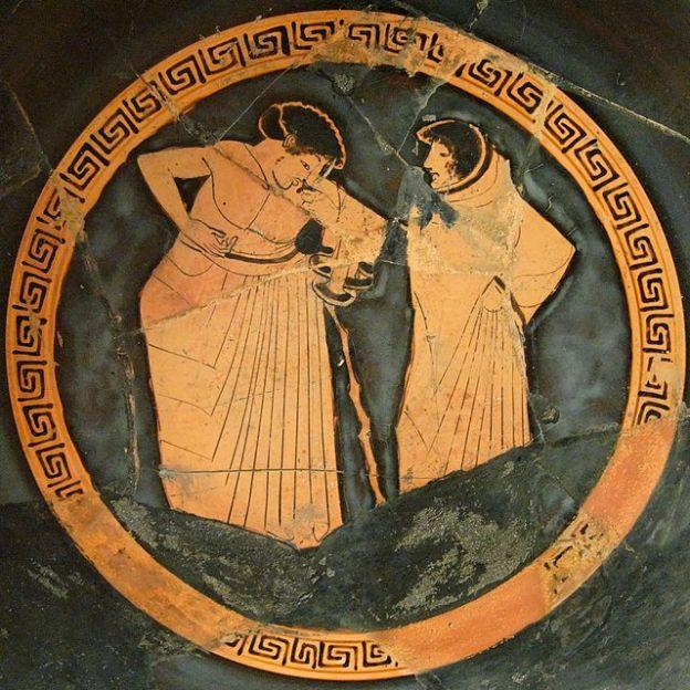 Pittore di Castelgiorgio. Due giovani a colloquio. Pittura vascolare dal tondo di una kylix attica a figure rosse, 500-480 a.C. ca. Museo Archeologico Regionale di Palermo